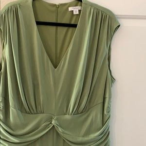A V- neck green dress pleated in the middle.
